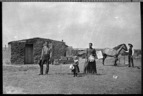 Family and sod home, Finney County, Kansas - Page