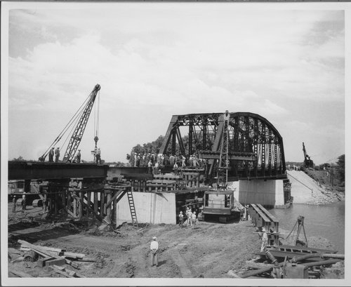 Photograph showing construction work on the Atchison, Topeka & Santa Fe Railway's bridge 102-C along the Neosho River in Neosho Rapids, 1950s.