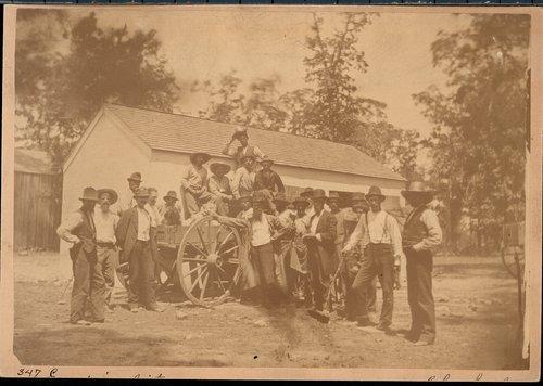 Men gathered around a wagon, Empire City, Kansas - Page