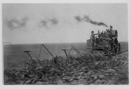Ed Angell and A. V. Angell plowing a field in Meade County, Kansas - Page
