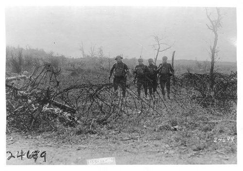Soldiers walking across a battlefield during World War I - Page