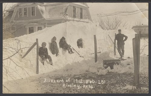 Pile of snow at the Sterrett home in Kinsley, Kansas - Page