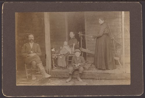 Family on the front porch of their home in Kansas, 1880 - Page