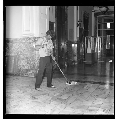 Doug Wadsworth cleaning a floor at the Memorial Building in Topeka, Kansas - Page