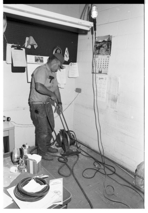Warren Pugh working on an electrical problem - Page