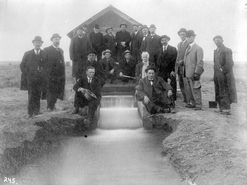 People posed by an irrigation canal in Finney County, Kansas - Page