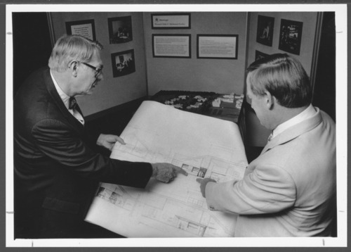 W. Walter Menninger, M.D., and Jack Allen with building plans and models - Page