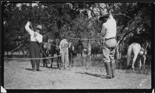 Cowboys twirling ropes - Page