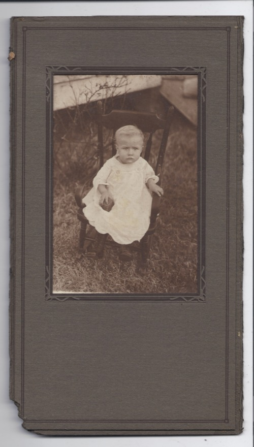 Child sitting on a rocking chair - Page