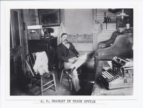 Joseph Calvin Bradley in the grain office, Rossville, Kansas - Page