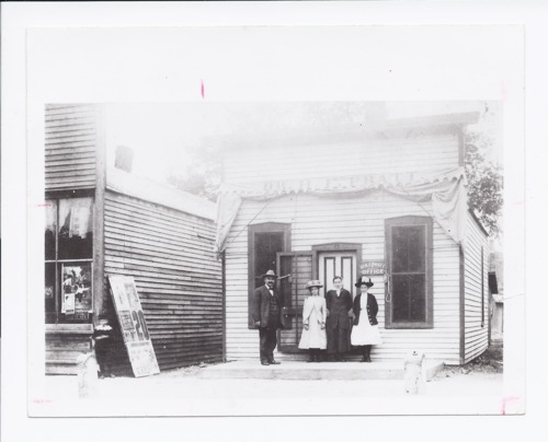 Dr. Henry Fuller Pratt with friends outside his office, Rossville, Kansas - Page