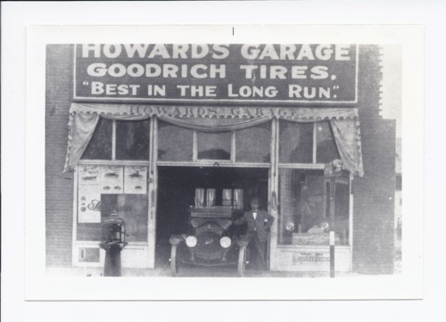 E.J. Howard in front of Howard's Garage, Rossville, Kansas - Page