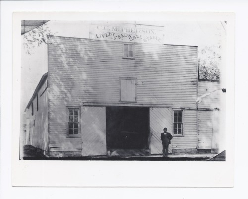 Ed Stovall outside C.C. McPherson's Livery, Rossville, Kansas - Page