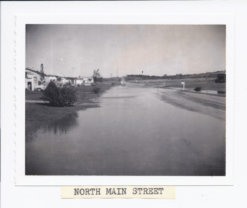 Main street during the 1961 flood, Rossville, Kansas - Page