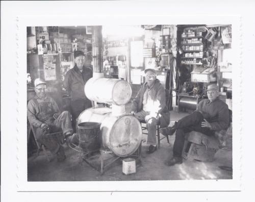 Four men in Olson's Garage, Rossville, Kansas - Page