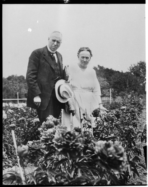 Dr. C. F. and Flo V. Menninger in their peony garden - Page