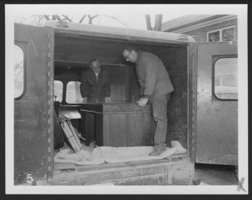 Moving a desk at the Menninger Clinic in Topeka, Kansas - Page