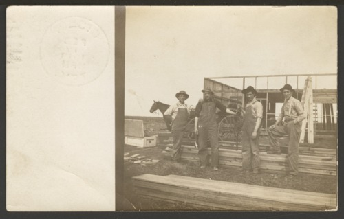 Men constructing a building - Page