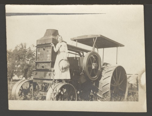 Woman on a steam powered tractor - Page