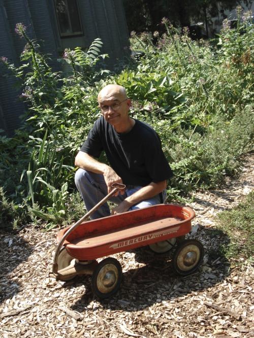 Richard Klocke with a Mercury wagon in Lawrence, Kansas - Page
