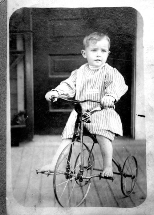Boy on tricycle - Page