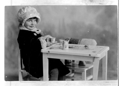 Girl serving tea - Page