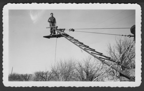 Early apparatus used to reach electrical lines in Lindsborg, Kansas - Page