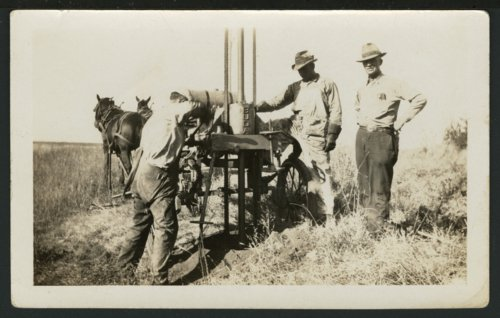 Drilling a hole for an electric pole near Solomon, Kansas - Page