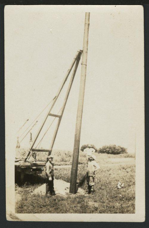 Setting an electric pole near Solomon, Kansas - Page