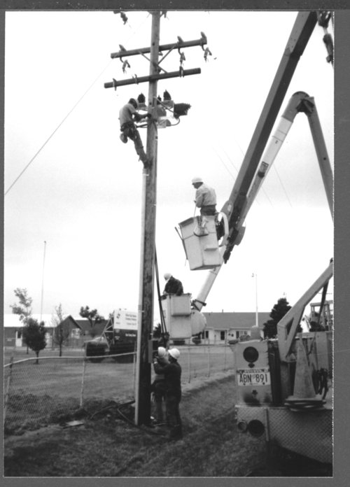 DS&O Rural Electric Cooperative's employees working on electric lines - Page