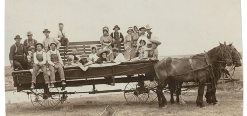 Group of people in a horse drawn wagon near Grainfield, Kansas - Page