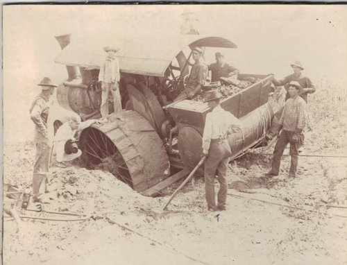 Tractor wheel in a hole on the Thomas Bishop Albin farm near Grainfield, Kansas - Page