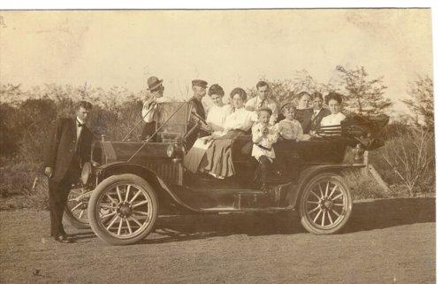 Edwin Boyer cranking his Buick automobile near Grainfield, Kansas - Page