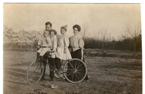 Group posed with a bicycle near Grainfield, Kansas - Page