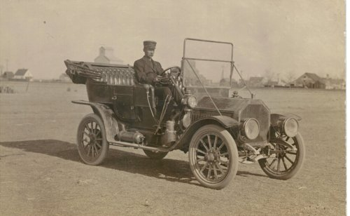 Edwin Boyer driving his Buick in Grainfield, Kansas - Page