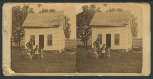 Family with their home possibly in Manhattan, Kansas - Page