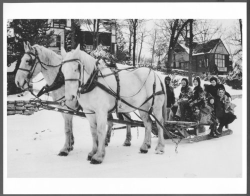 People on a horse-drawn sled at Lake Quivira, Kansas - Page