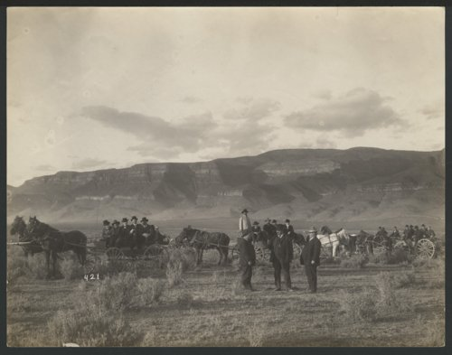 Men with horse drawn wagons possibly in Colorado - Page