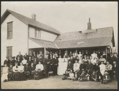 People in front of a house possibly in Seward County, Kansas - Page