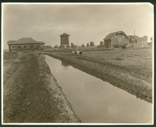 Farm with an irrigation canal or ditch possibly in Seward County, Kansas - Page