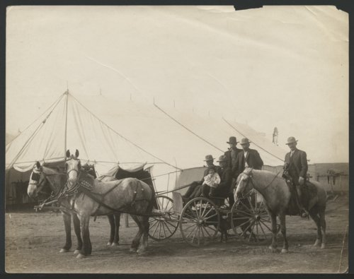 Men in a horse-drawn carriage, possibly in Seward County, Kansas - Page
