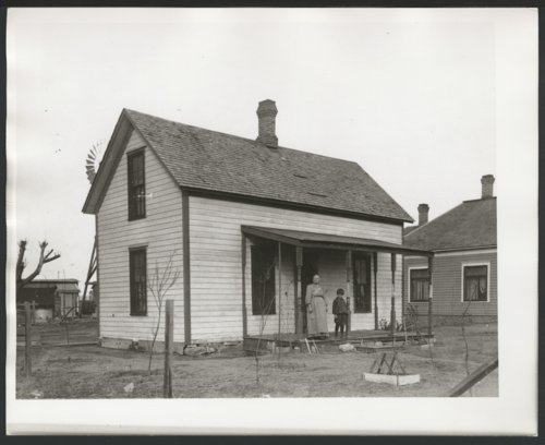 Unidentified woman and boy on the porch of a house in Liberal, Kansas - Page