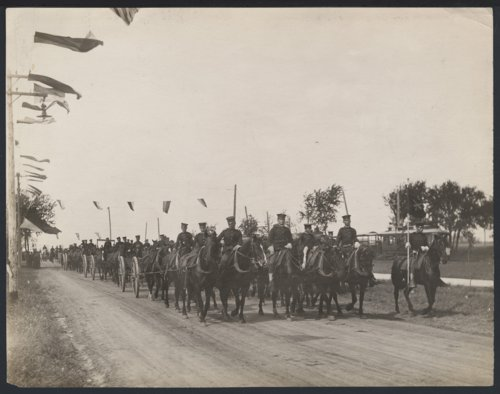 Soldiers on horseback parading in Liberal, Kansas - Page