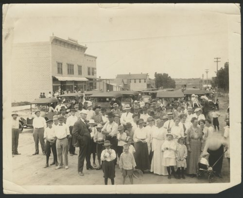 Group of people on a street in an unidentified town - Page
