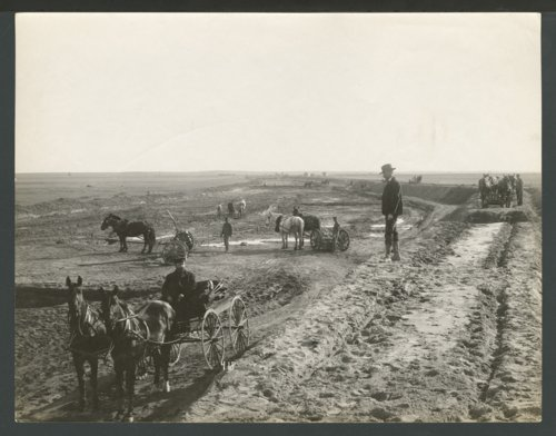 Constructing a canal or ditch, possibly in Seward County, Kansas - Page