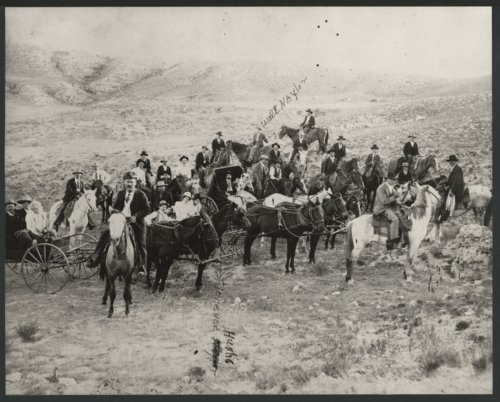 Group of unidentified people on horseback and in carriages possibly in Seward County, Kansas - Page