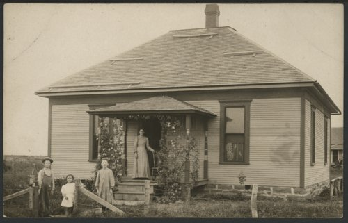 Unidentified family with their house - Page