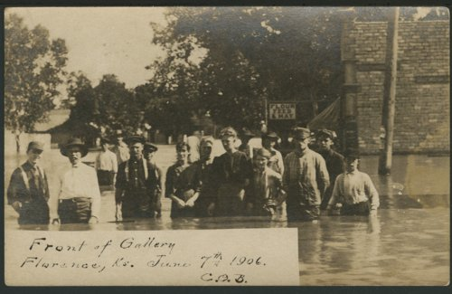 People in flood waters in front of the gallery in Florence, Kansas - Page