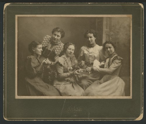 Five unidentified women eating candy - Page