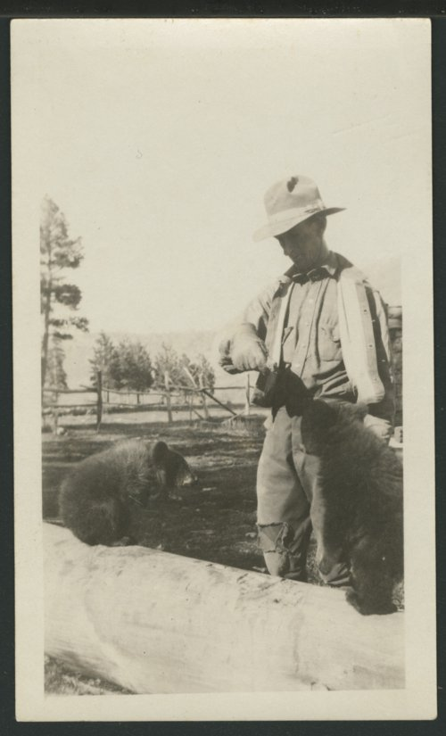 Lee Larrabee feeding his bear cubs - Page